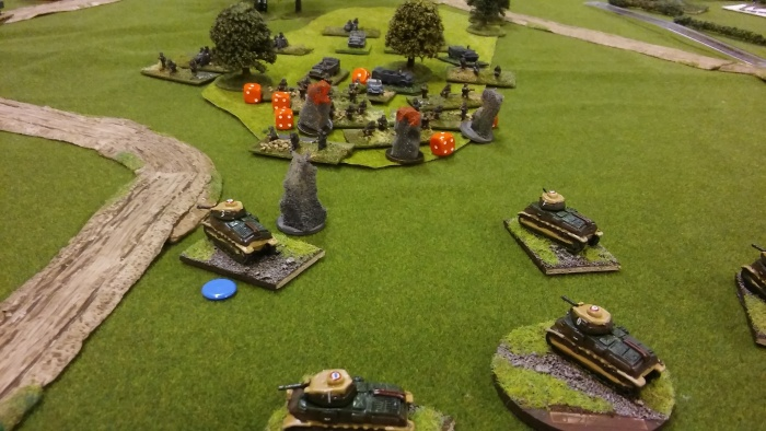 Somuas hold on whilst the artillery mullers the Germans in the wood.