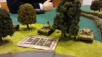 The Pz III's crash into the wood.