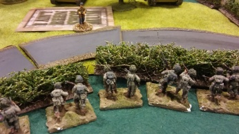 My left flank platoon safely retreat to the hedge and spy the encroaching Germans.